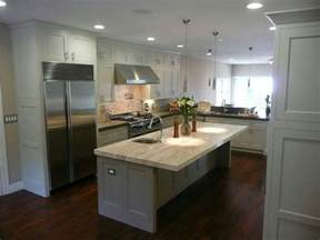 white kitchens with islands dark wood floors grey island white cabinets light counters and chrome fixtures but with grey