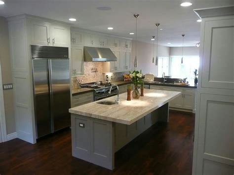 white kitchen cabinets dark wood floors dark wood floors grey island white cabinets light counters