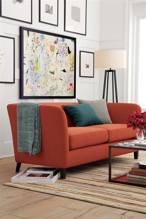 rust color living room rust and teal in a living room by crate barrel decoist