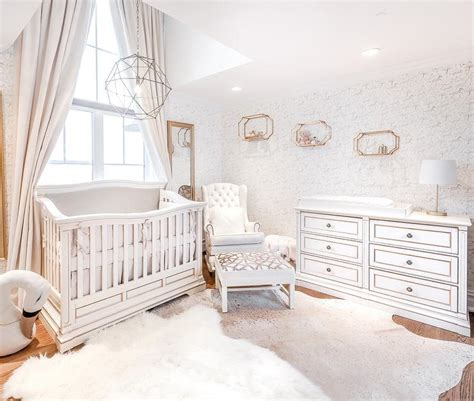 Cowhide Rug Nursery - white and gray nursery with light gray cowhide rug