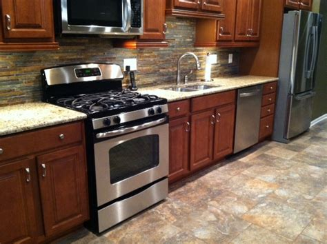 Kitchen Floor Ideas With Cherry Cabinets New Kitchen With Merrillat Cherry Stained Maple Wood Cabinets Granite Counter Tops Slate