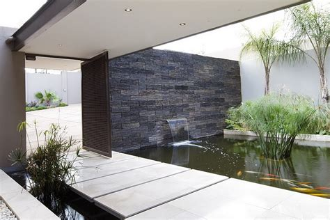 modern water features water feature at the entrance of the house decoist