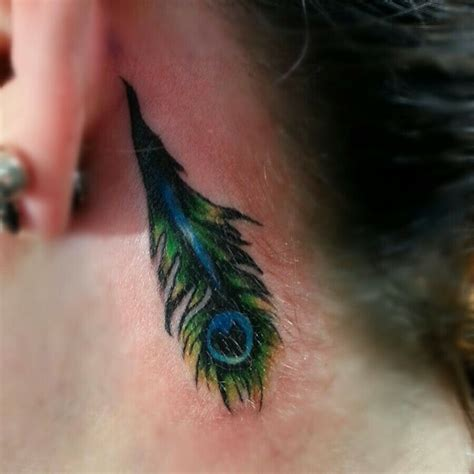 feather tattoo designs behind ear peacock feather the ear