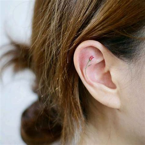 flower tattoo in ear with piercing best 20 inner ear tattoo ideas on pinterest ear tattoos