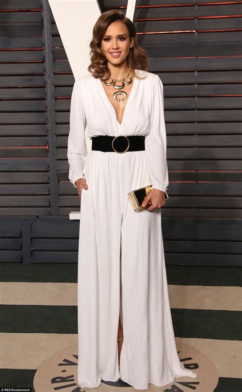 Dress Alba alba wears plunging white gown at vanity fair s