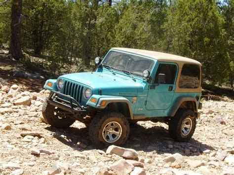jeep wrangler teal i will have you someday 97 teal jeep wrangler with tan