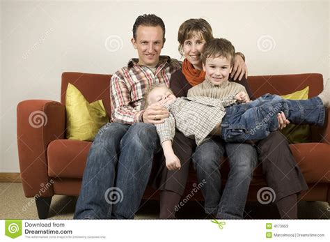 couch family family on a couch 5 stock photos image 4173953