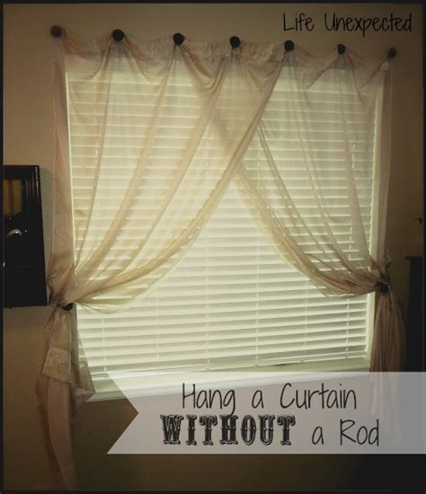 how to put up curtain rods life unexpected how to hang a curtain without a rod