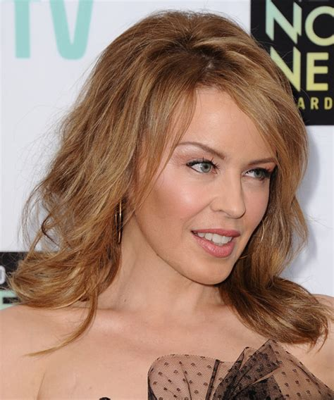 casual chignon updo hairstyle for women kylie minogue hairstyle over 30 short hair pics for women short hairstyle 2013
