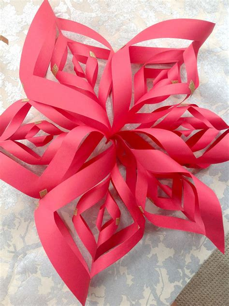 Paper Ornaments To Make - make a paper snowflake ornament hgtv