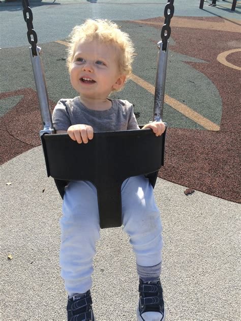 age for baby swing at park billy at the playground baby dot organic