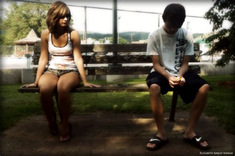 what is benching someone file young couple sitting apart on park bench jpg