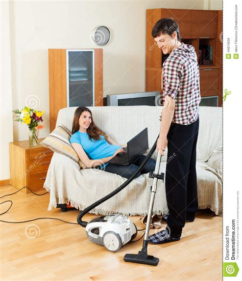 The Notebook House Floor Plan Man Cleaning While Woman Lying With Notebook Stock Photo
