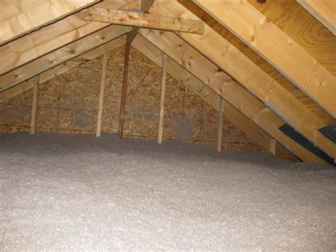 Ceiling Attic Blown Insulation Is Added To The Attic Floor Building