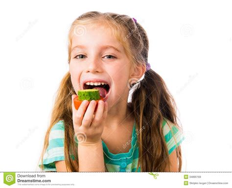 girl with cucumber little girl with cucumbers and tomatoes royalty free stock