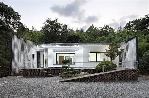 namhae house renovation a metallic suit facade japanese