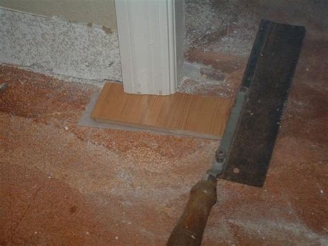 under cutting door jambs with a hand saw before