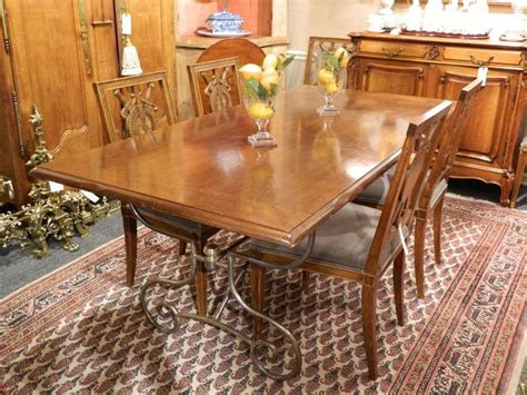 spanish style mahogany and silvered metal dining table