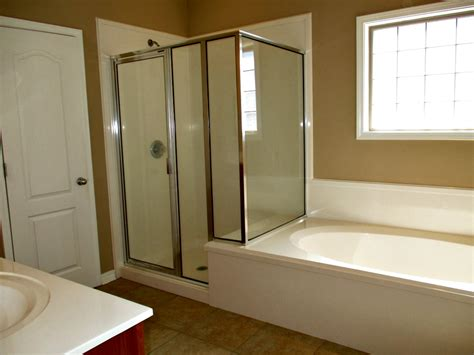 bathroom with separate shower and bathtub 9651 nottingham ct mobile al 36695 the cummings company