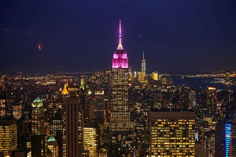 empire state lights today glamour lights up the empire state building in pink for