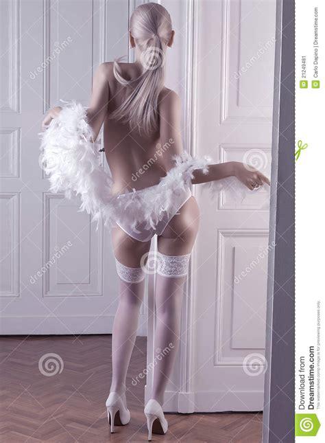 long hait back shot glamour shot of a long hair blonde in lingerie stock image