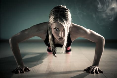 imagenes fitness hd a woman doing pushups in the gym health hd wallpaper