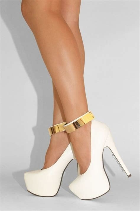 gold and white high heels gold plate accent oversized high heel pumps
