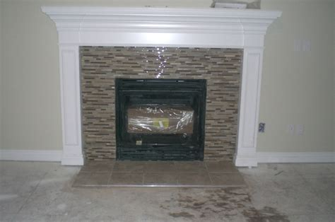Ceramic Tile Fireplace by I Had Glass Mosaic Tile Sheets Used On Our Fireplace
