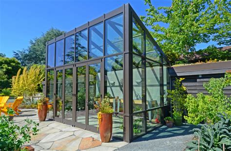 Barn Style Garage by 10 Gorgeous Greenhouses To Get You Excited For Spring