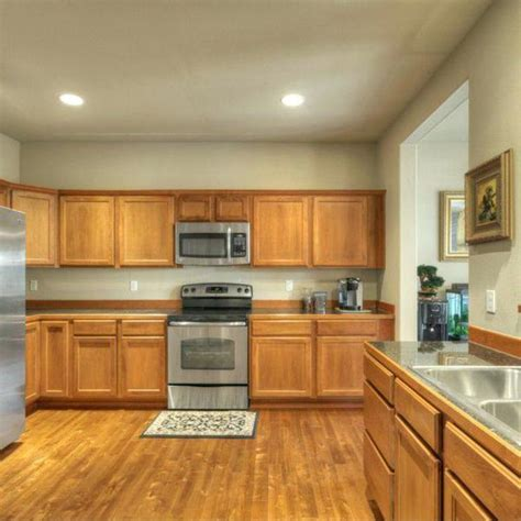 Should You Put Laminate Flooring Under Kitchen Cabinets Putting Up Kitchen Cabinets