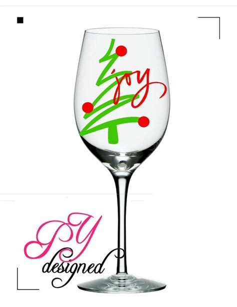 christmas wine glass with christmas tree and joy