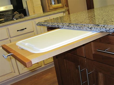 cutting kitchen cabinets how to install a pull out cutting board in kitchen cabinet