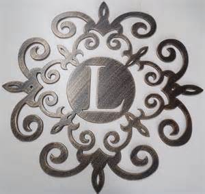 family initial monogram inside a metal scroll with l