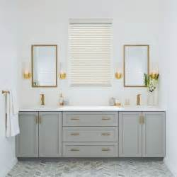 bathroom cabinet hardware with green walls vanity lighting