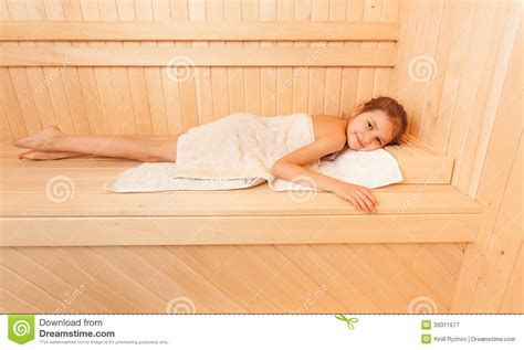 Massage Chairs For Less Cute Little Relaxing On Bench At Sauna Stock Image