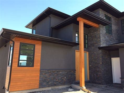 modern home by mdt homes kamloops bc with charcoal ledgestone from realstone systems modern