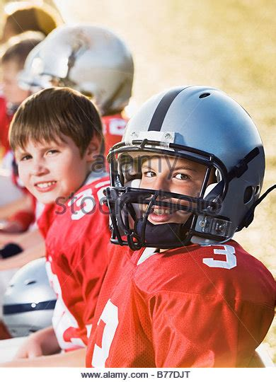 football player on bench football players sitting on bench stock photos football players sitting on bench