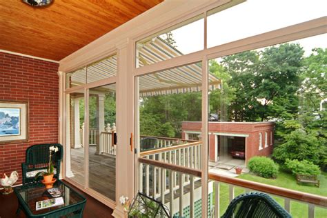 Sunroom On Existing Deck sunroom and retractable awning on existing deck