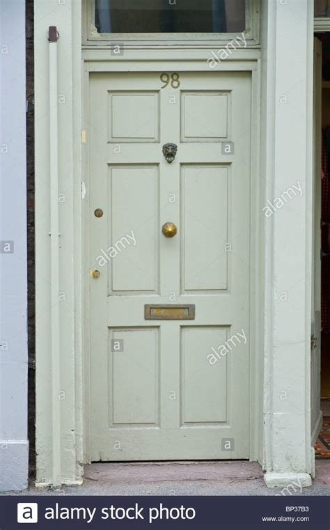 Front Door Ironmongery Gray Painted Wooden Paneled Front Door No 98 With Brass Letterbox Stock Photo Royalty Free