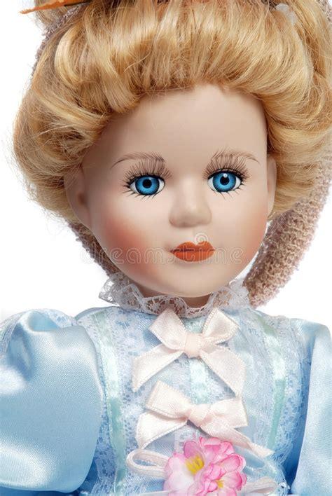 antique 3 faced porcelain doll portrait of antique porcelain doll stock photo