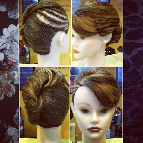 scalp braids in a french twist pinned twist updo with cornrow on scalp braids and a
