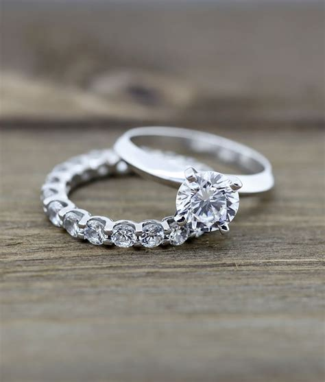 knife edge engagement ring and oasis eternity band
