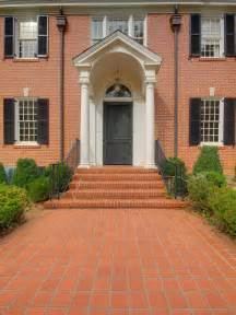 Black front door on red brick home the black front door gives a