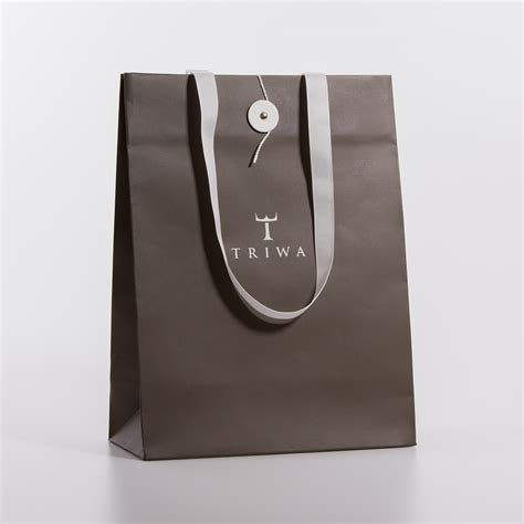with paper bags ribbon handle paper bag avisera ab the wrap artist