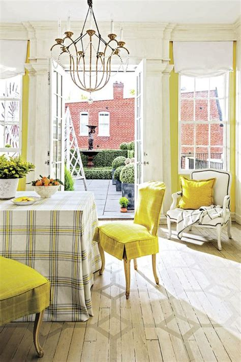 this country dining room has a yellow color scheme with