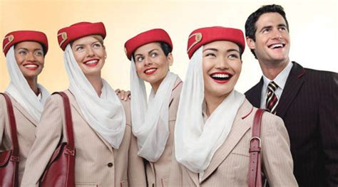 Emirates Staff   emirates staff laugh while kitten dangles from balcony