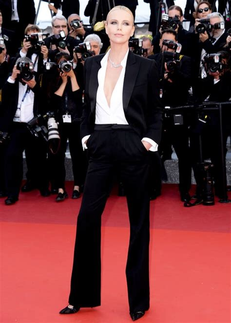 Festival Fashion Brangelina And Charlize Hit The Carpet In Venice And Deauville by Charlize Theron Stuns In Tuxedo At Cannes 2016 Carpet