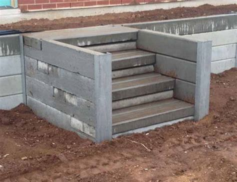 Concrete Sleeper Retaining Wall Installation by Retaining Walls And Concrete Sleepers Adelaide Fence Centre