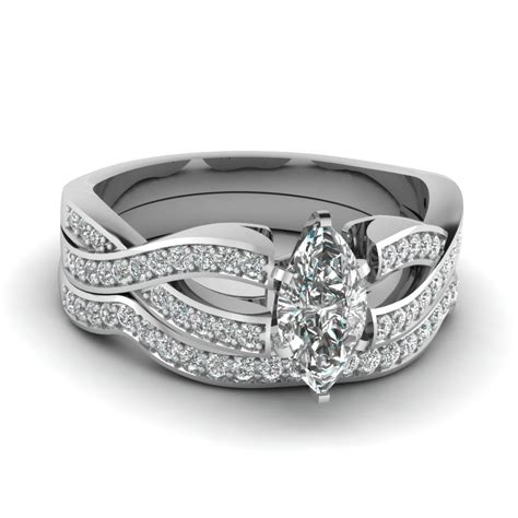 marquise cut twist pave engagement ring with