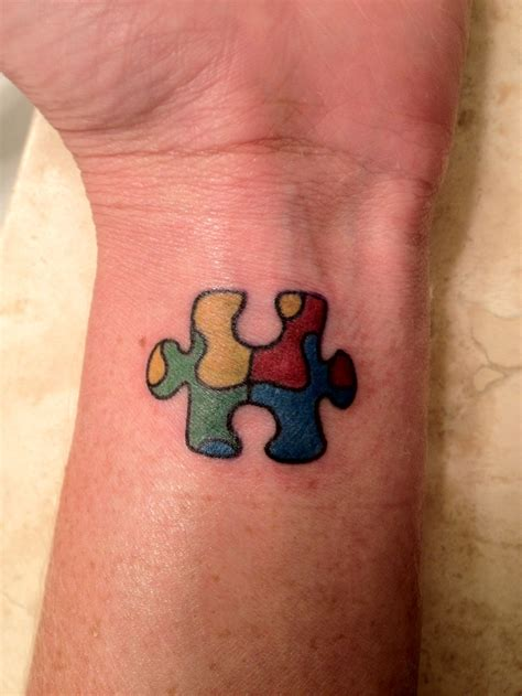 autism puzzle piece tattoos autism awareness for my lilly tattoos